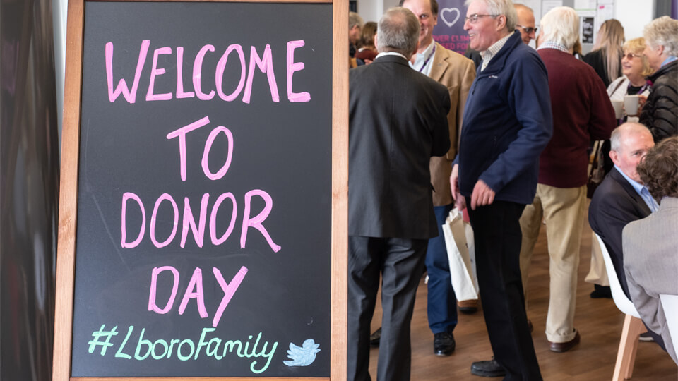a chalkboard sign saying welcome to donor day