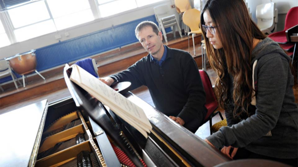 Tutor and pianist during piano lesson