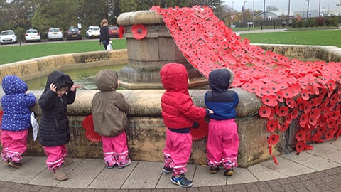 Children attending Rememberance Service at the Fountain on Loughborough University campus