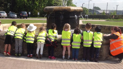 Children visit the fountain on Loughborough University campus