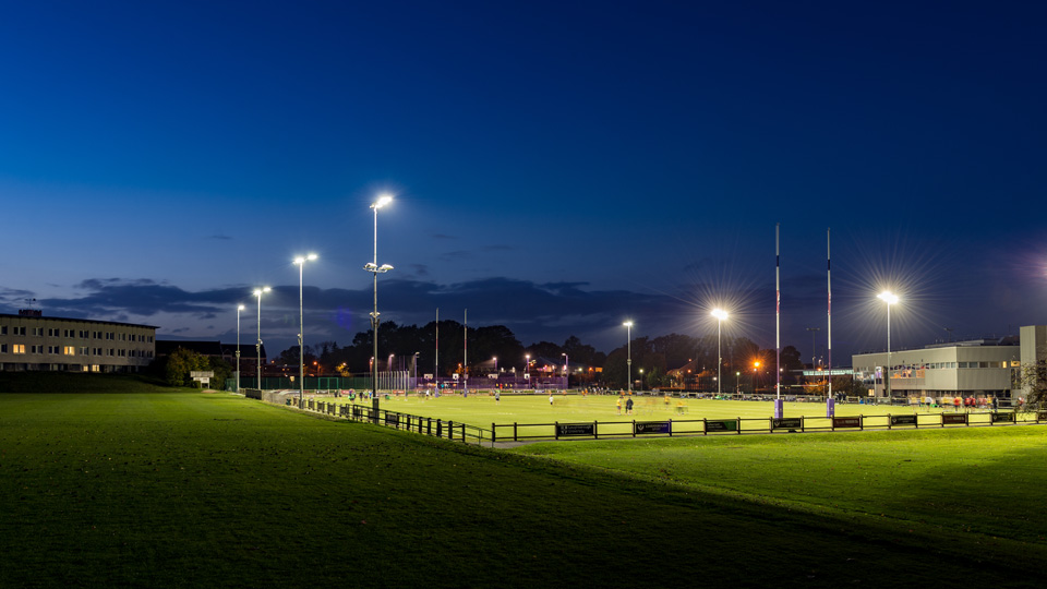 Rugby pitch at night with floodlights