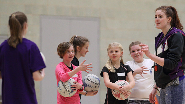 Smiling children during netball camp