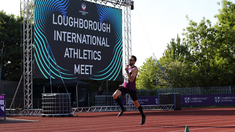 a man running around the track