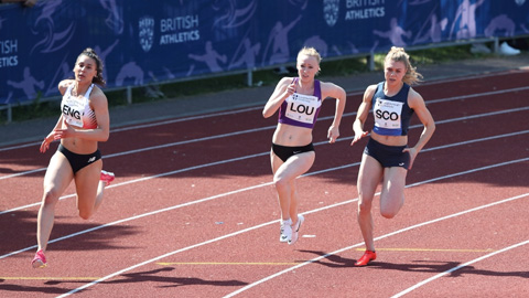 Beth Dobbin and two other runners on a track