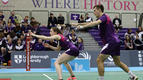 two people playing badminton