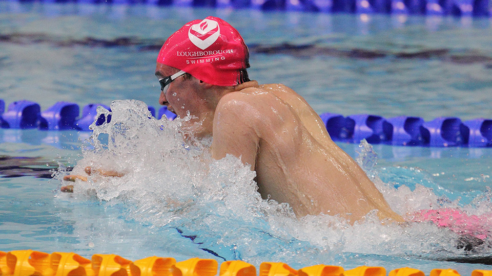 a man swimming breaststroke