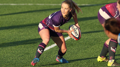 a player holding a rugby ball