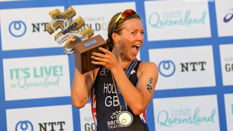 Vicky Holland holding her trophy