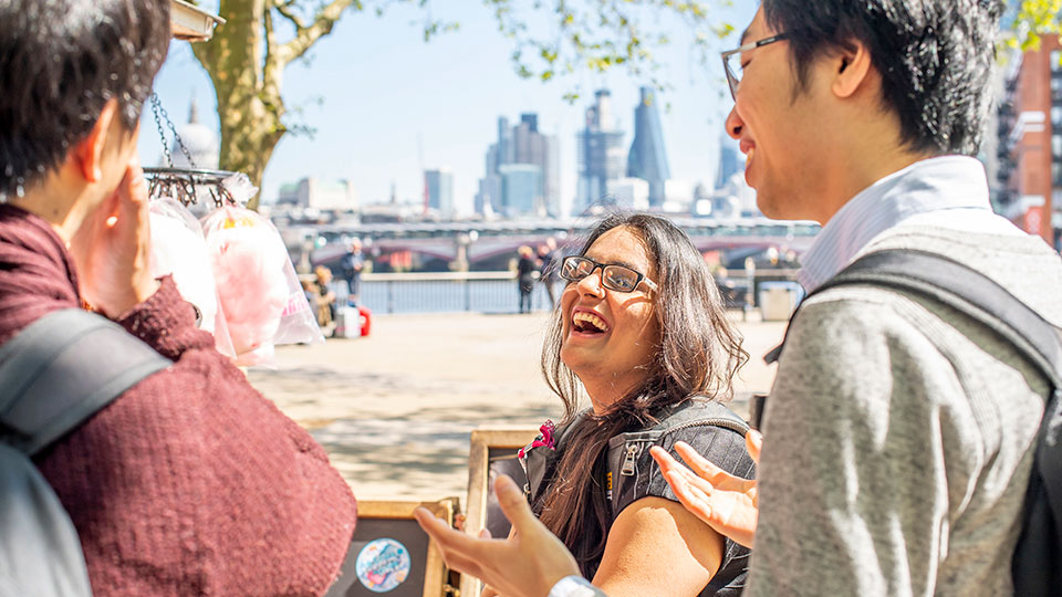A group of international students in London laughing