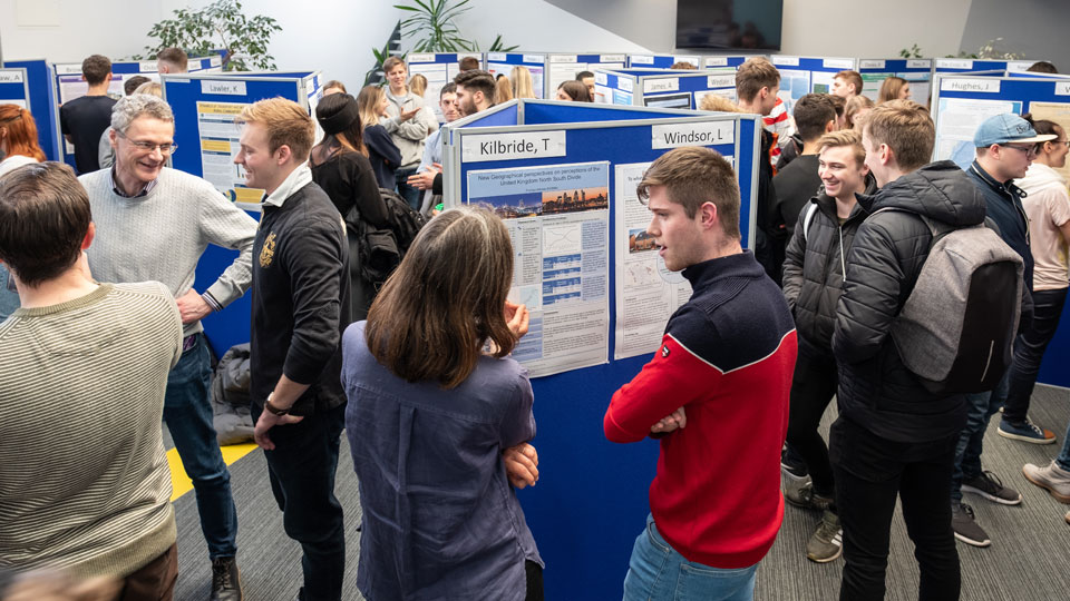 groups of people at the poster exhibition