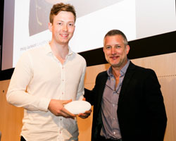 Phillip Jackson, with his award, and Richard Howarth, from Apple.