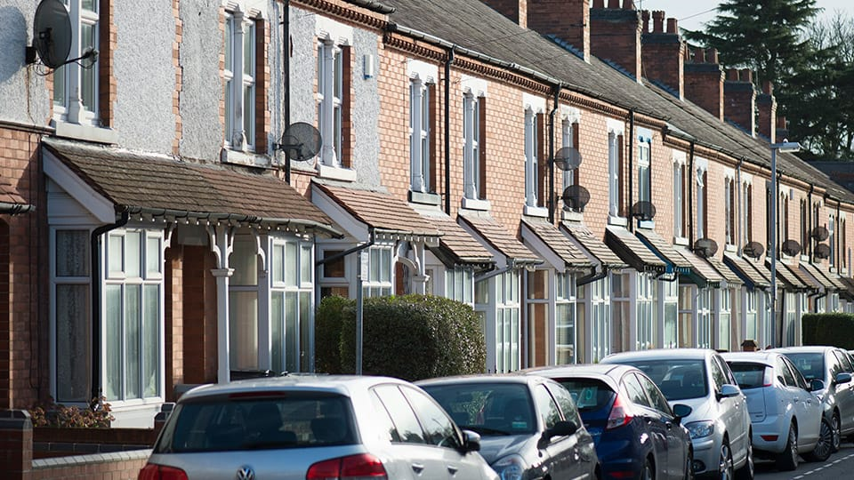 A Loughborough street with terrace housing and cars parked on the street