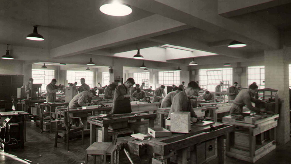 Historical image of items being produced at the handicraft unit