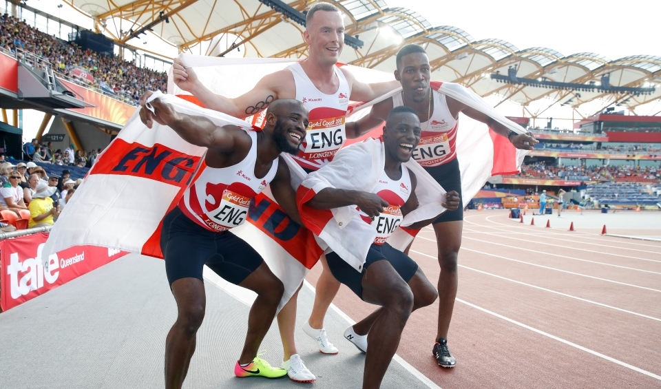 England celebrate winning gold in the 4x100m relay