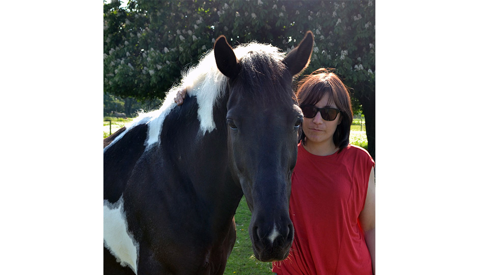 Pictured is Dr Carly Butler with Bilbo the horse.