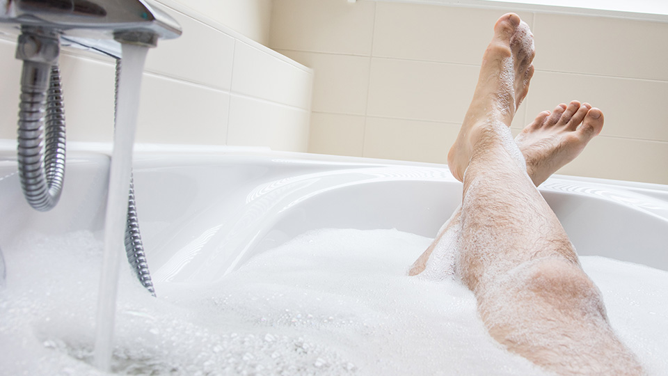 Pictured is a man's legs in a bath.