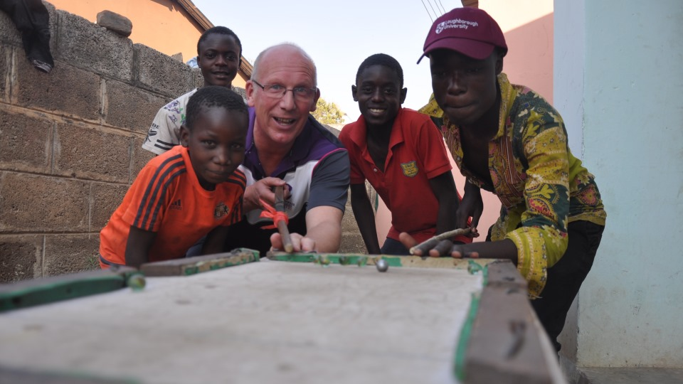 Vice Chancellor Professor Robert Allison interacting with youngsters in Zambia