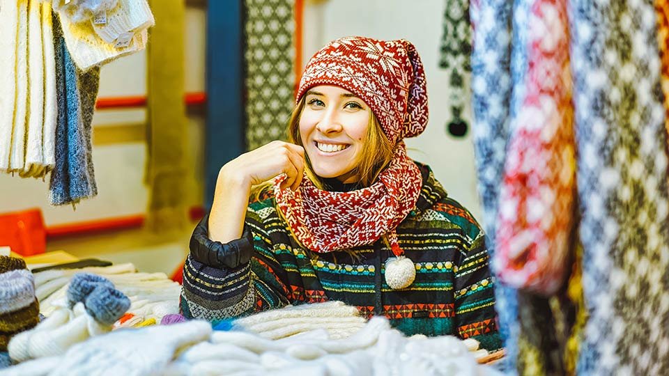 Pictured is a knit-maker at a stall.