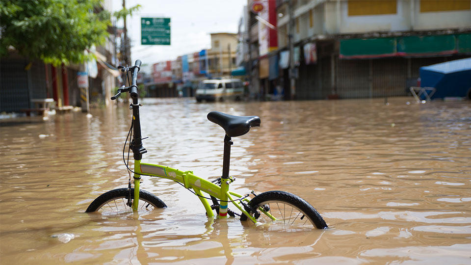 A bike in a flooded street