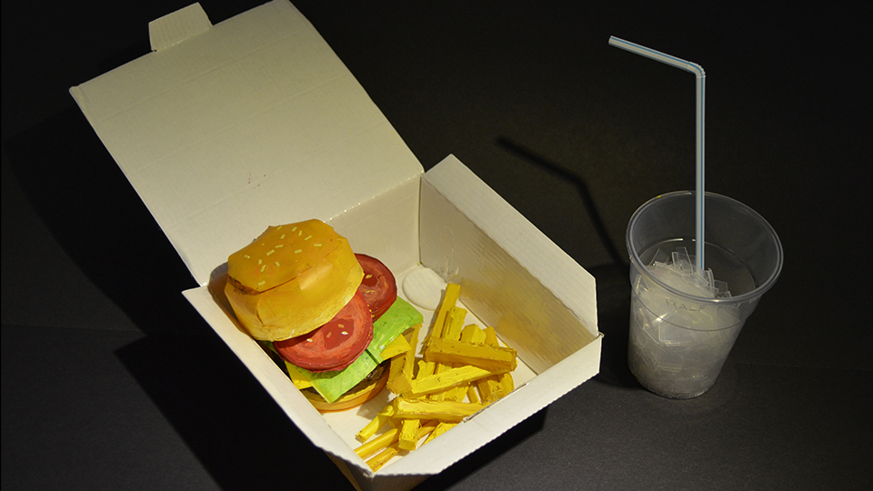 photo of student Maisie's work - a 'burger and chips meal' made entirely out of plastic cups