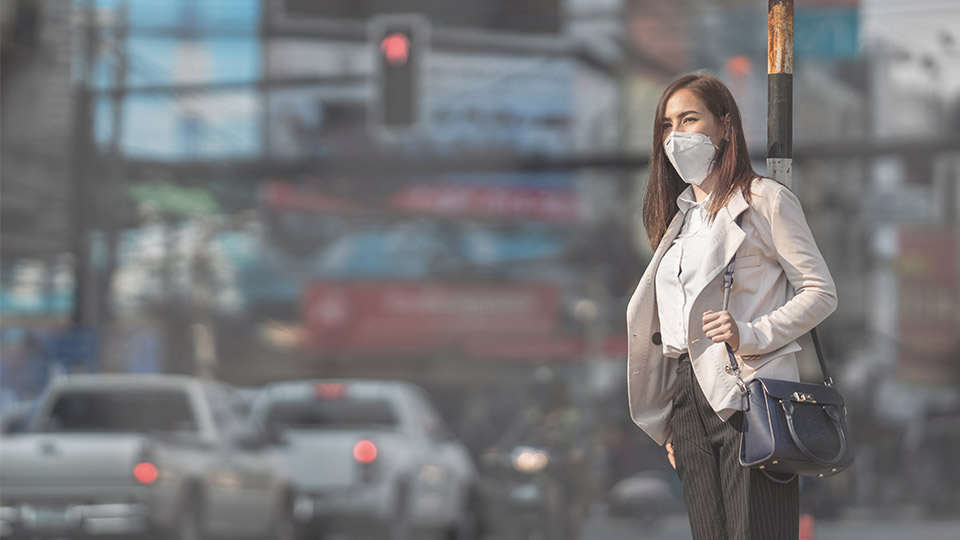 Woman with an air pollution mask on.
