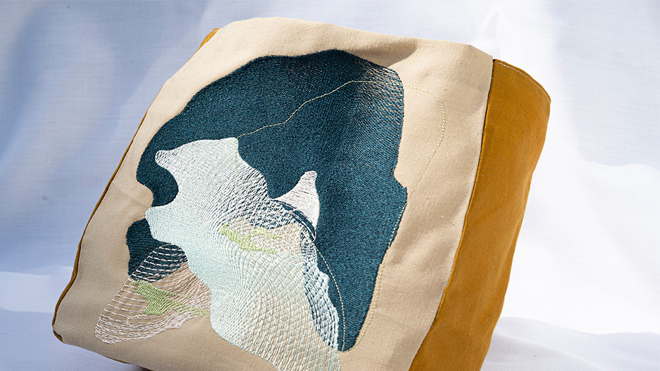Unrooted bag, made by Alice using biodegradable digital embroidery, reclaimed fabric and water-resistant oil cloth.