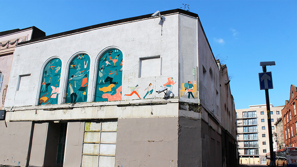 The Palais De Danse is the old dancehall where the 'lunchtime dances' would draw in crowds on a Friday. The illustration (which would form part of the trail) portrays women running back to work and a couple by a bus stop wrapping around the walls of the building.