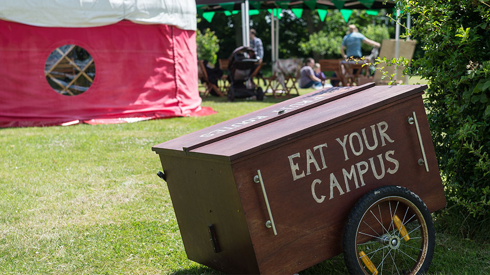 a wagon with the words 'eat your campus' painted on the side