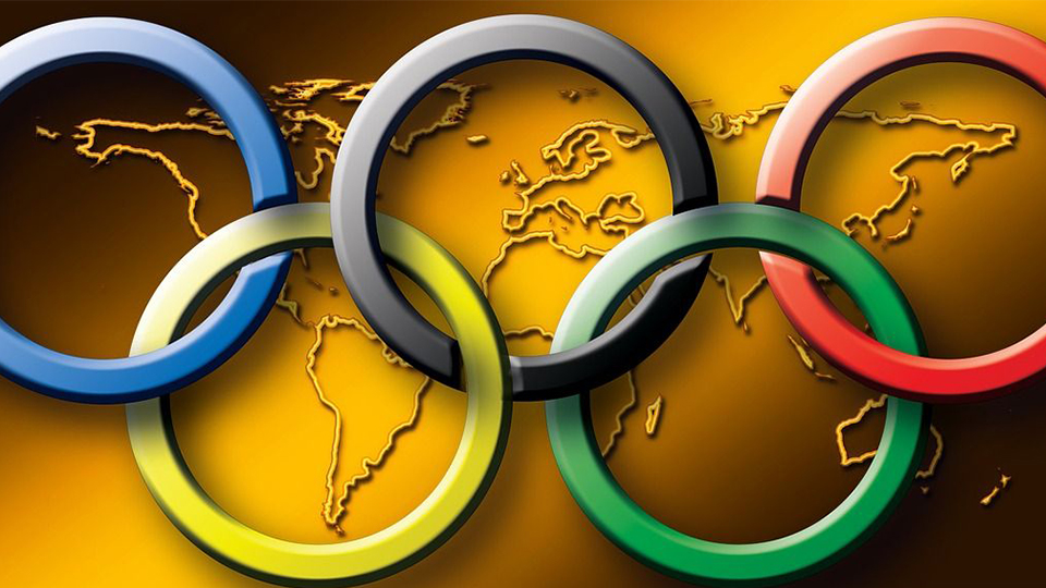 image of Olympic rings over the top of a World Map background