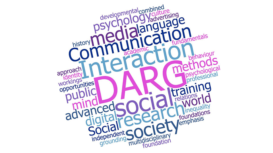 Pictured is the DARG logo, it is made up of a collection of words, in the colours pink, purple and blue, that relate to the group.
