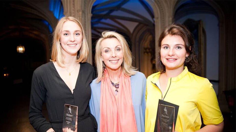 Fashion students receiving awards with Anne Davies