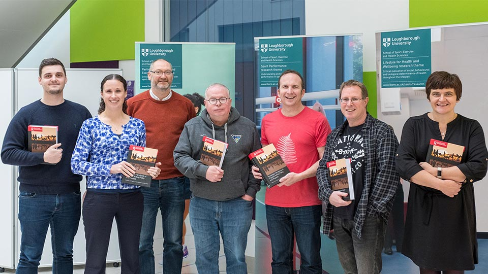 Pictured, from left to right, are Dr Andrew Kingsnorth, Dr Lauren Sherar, Prof Paul Downward, Prof Alan Bairner, Dr Joe Piggin, Dr Dominic Malcolm and Dr Carolynne Mason holding copies of the Routledge Handbook of Physical Activity Policy and Practice.
