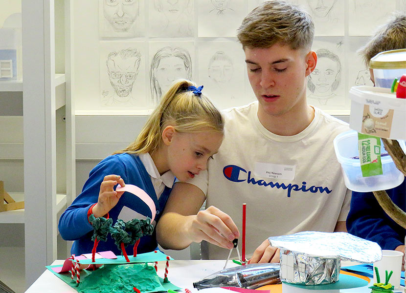 Loughborough University student helps St Bart's pupil with their classroom design.