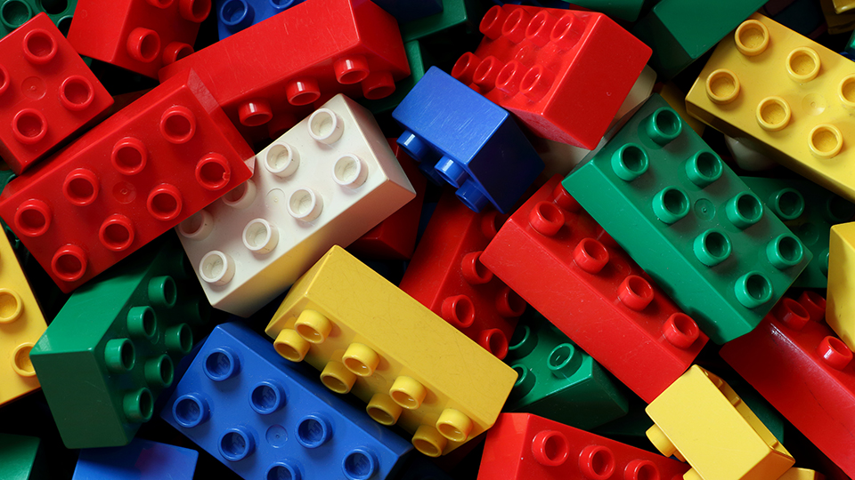 blocks of different coloured lego bricks piled on top of each other