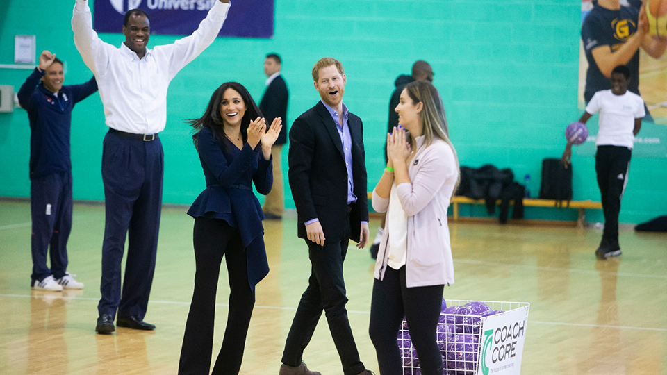 photo of Duke and Duchess of Sussex Prince Harry and Meghan playing netball with coaches and sportstars