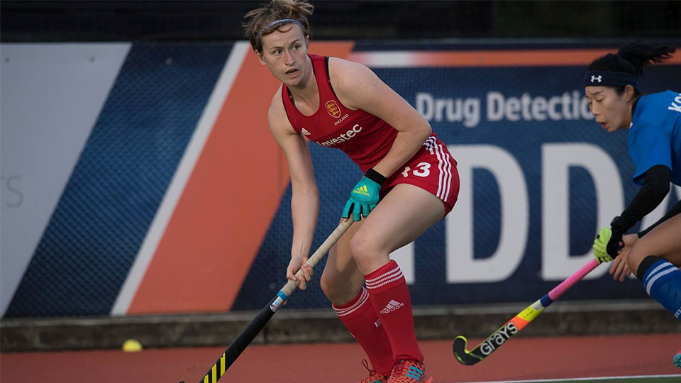 photo of Ellie Rayer, Loughborough student playing hockey