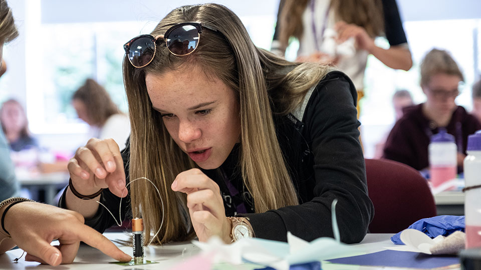 Pictured is a student working at the 'Year 10 Girls into STEM' residential.