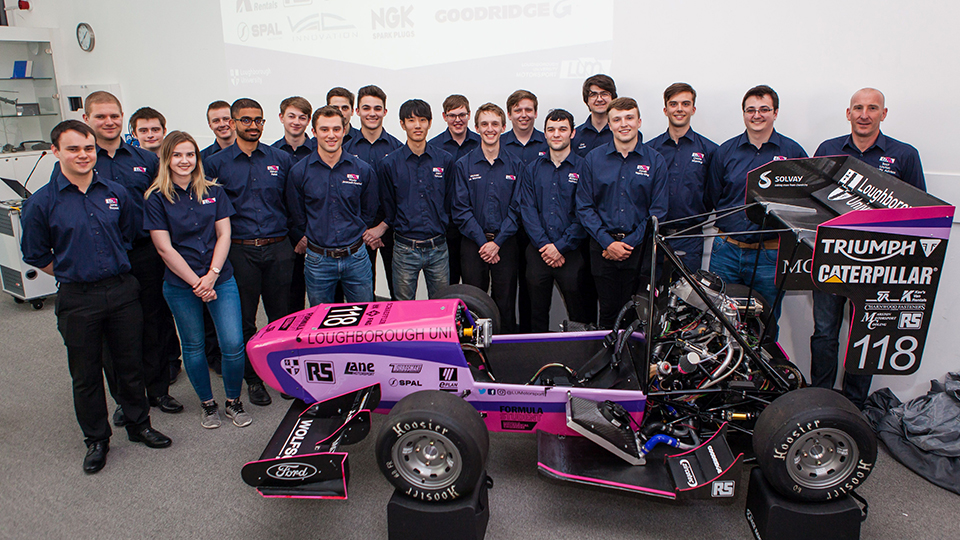 photo of the Formula Student team with the 2018 racing car