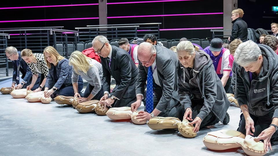 Pictured are staff learning CPR at the Heart 2 Heart event.