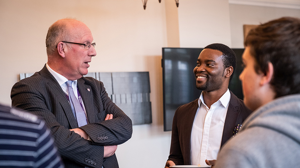 photo of Robert Allison and a scholarship student, Michael, at the presentation event