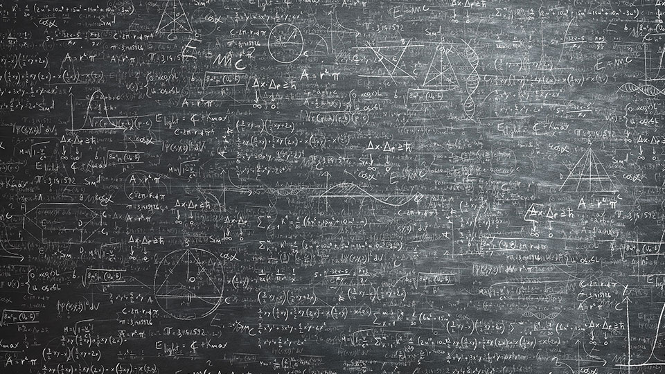 photo of a black filled with mathematical equations