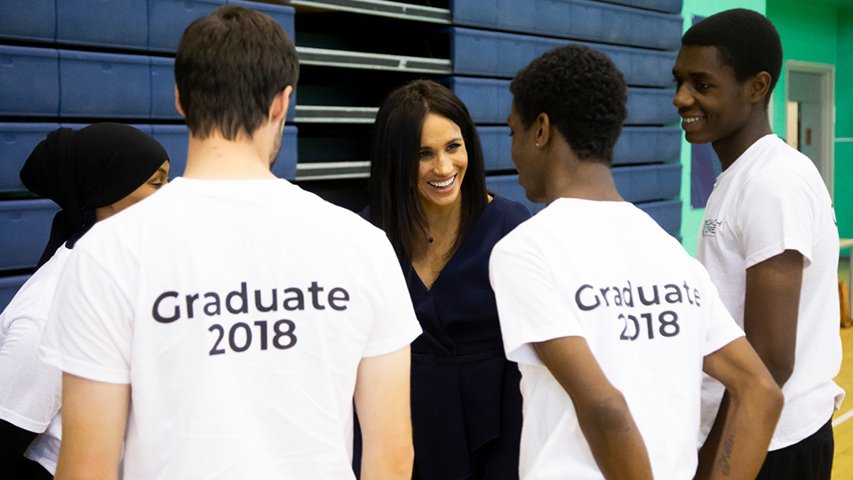 photo of Duchess of Sussex Meghan talking to Coach Core coaches