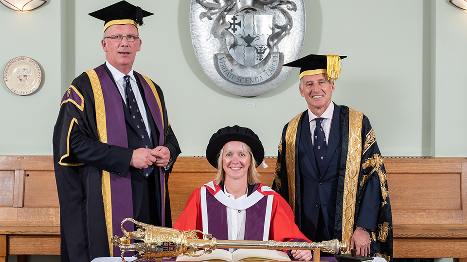 photo of Mel Marshall at graduation with Seb Coe and Bob Allison