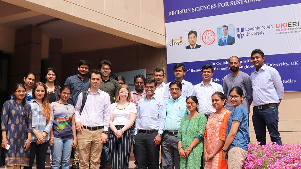 Pictured fourth to the right is Professor Ravi Shankar with Dr Alok Choudhary to his left.