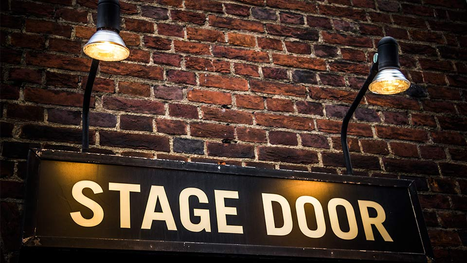 Pictured is a stage door sign.