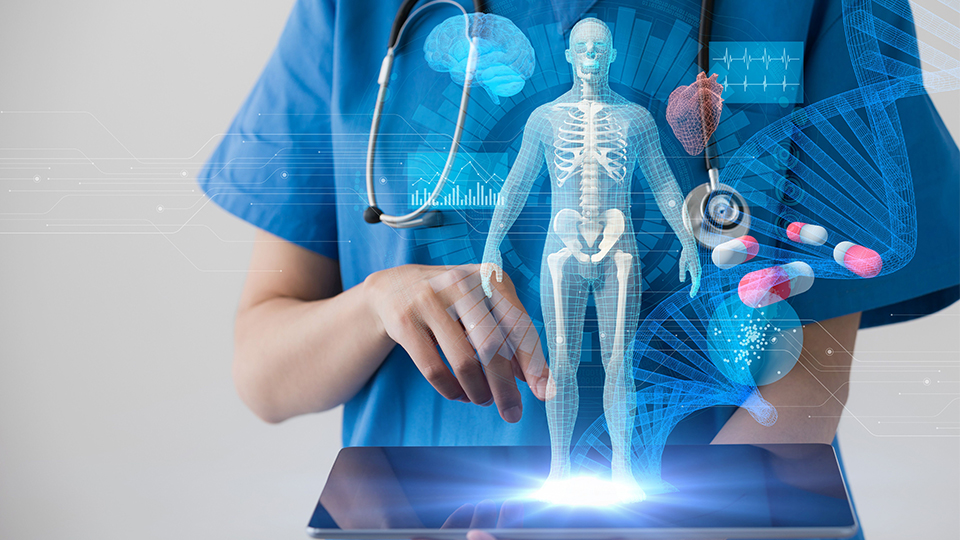 photo of a healthcare worker holding a tablet with health-related holographics showing above