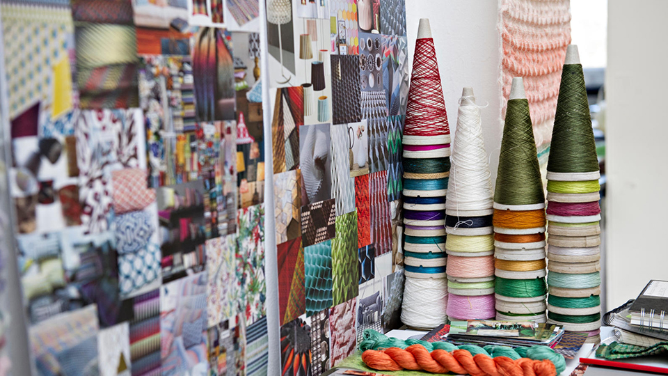 photo of student textile work and woven fabric