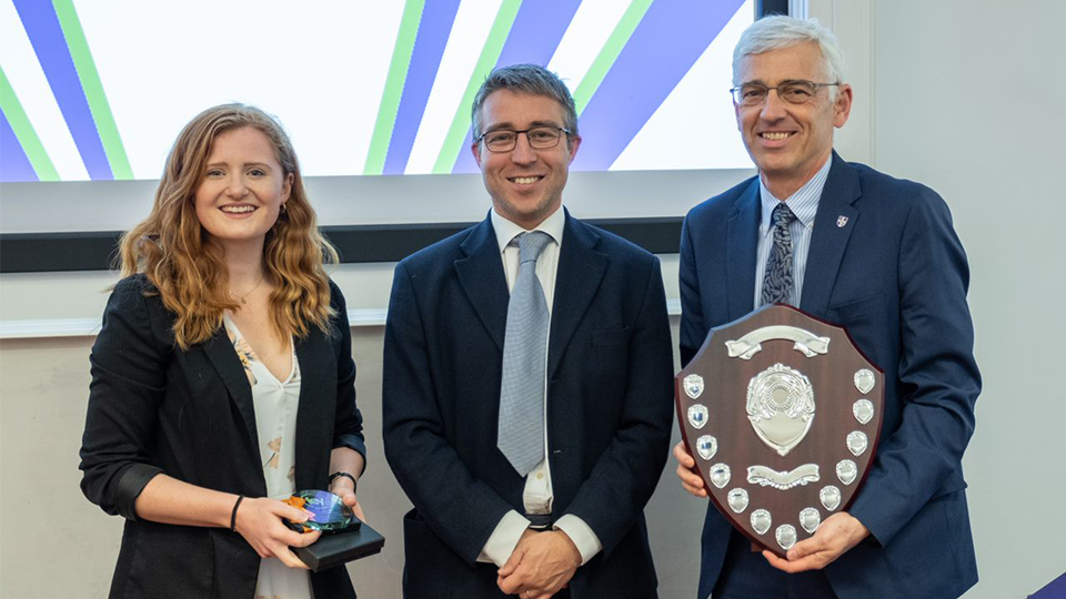 Photo of UG winner Hannah accepting her award, with Guy Blundell and Professor Chris Rielly