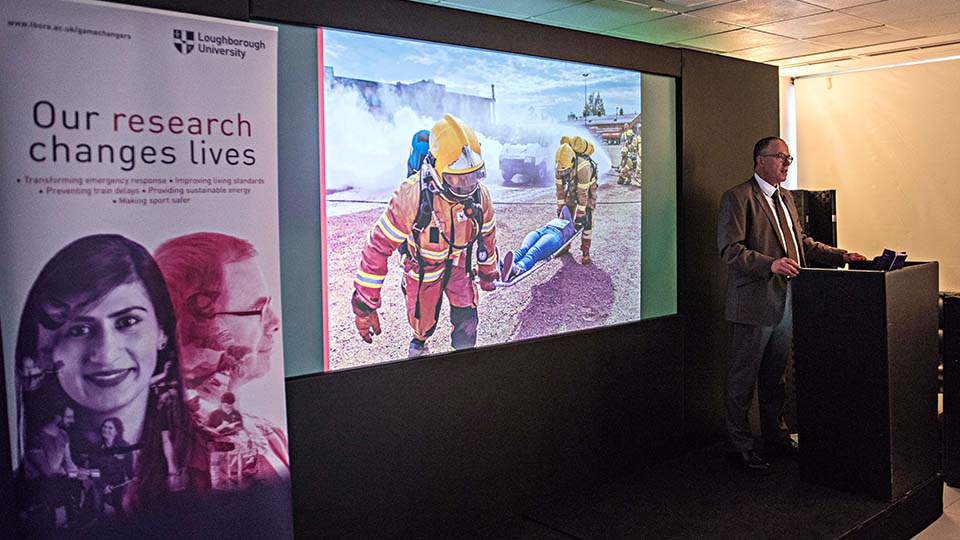 Photo of Professor Paul Thomas speaking at the research showcase in London