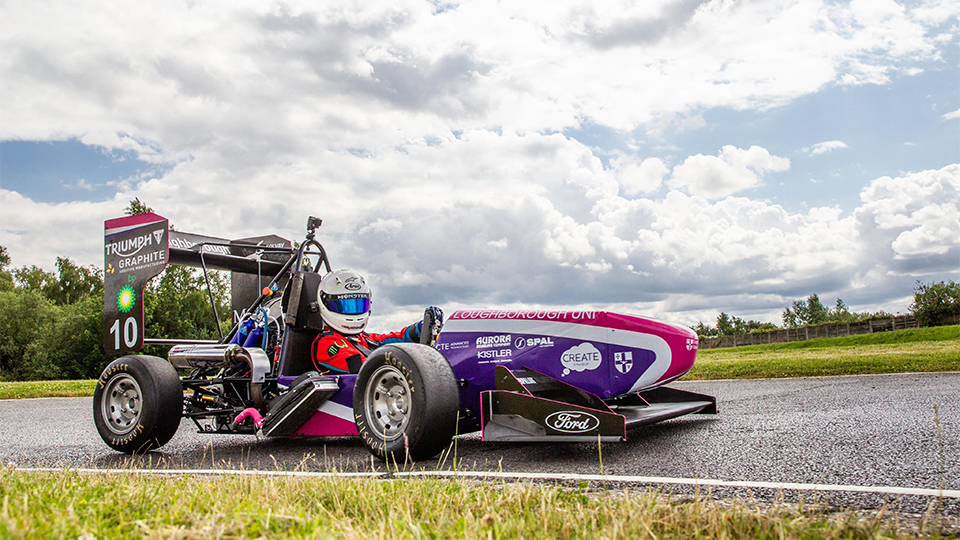 Photo of the 2019 car on race track with driver